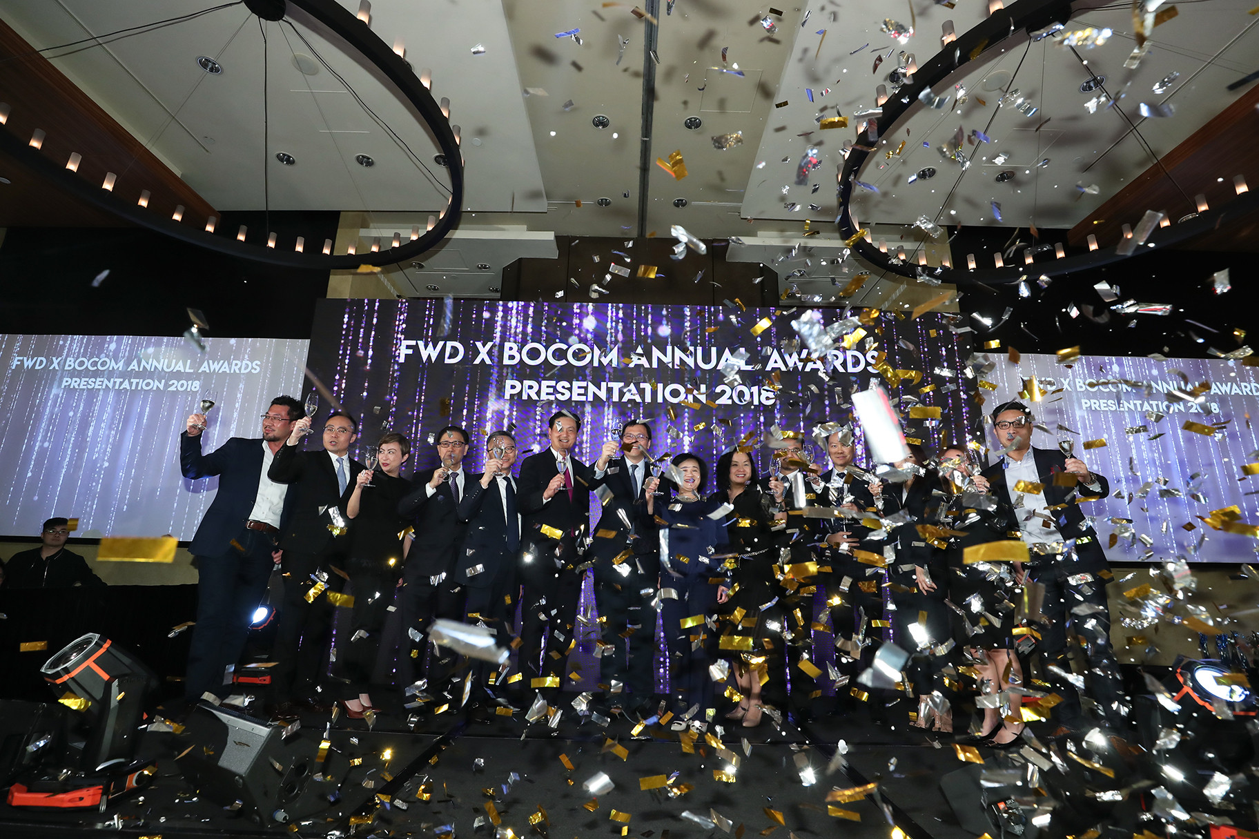 FWD x BOCOM stage with confetti and management with champagne