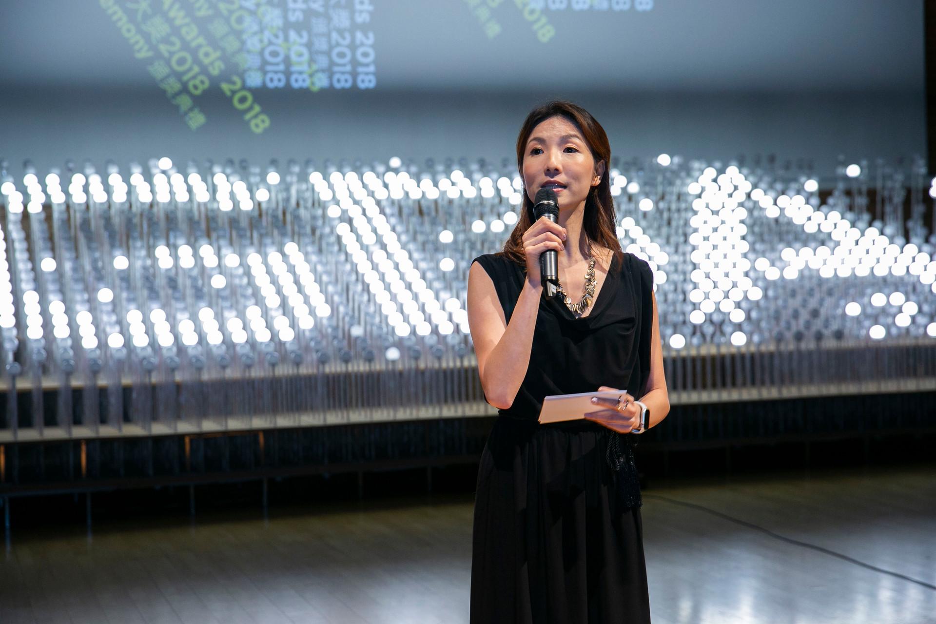 Asian women MC in black dress with microphone in HKDA Global Design Awards