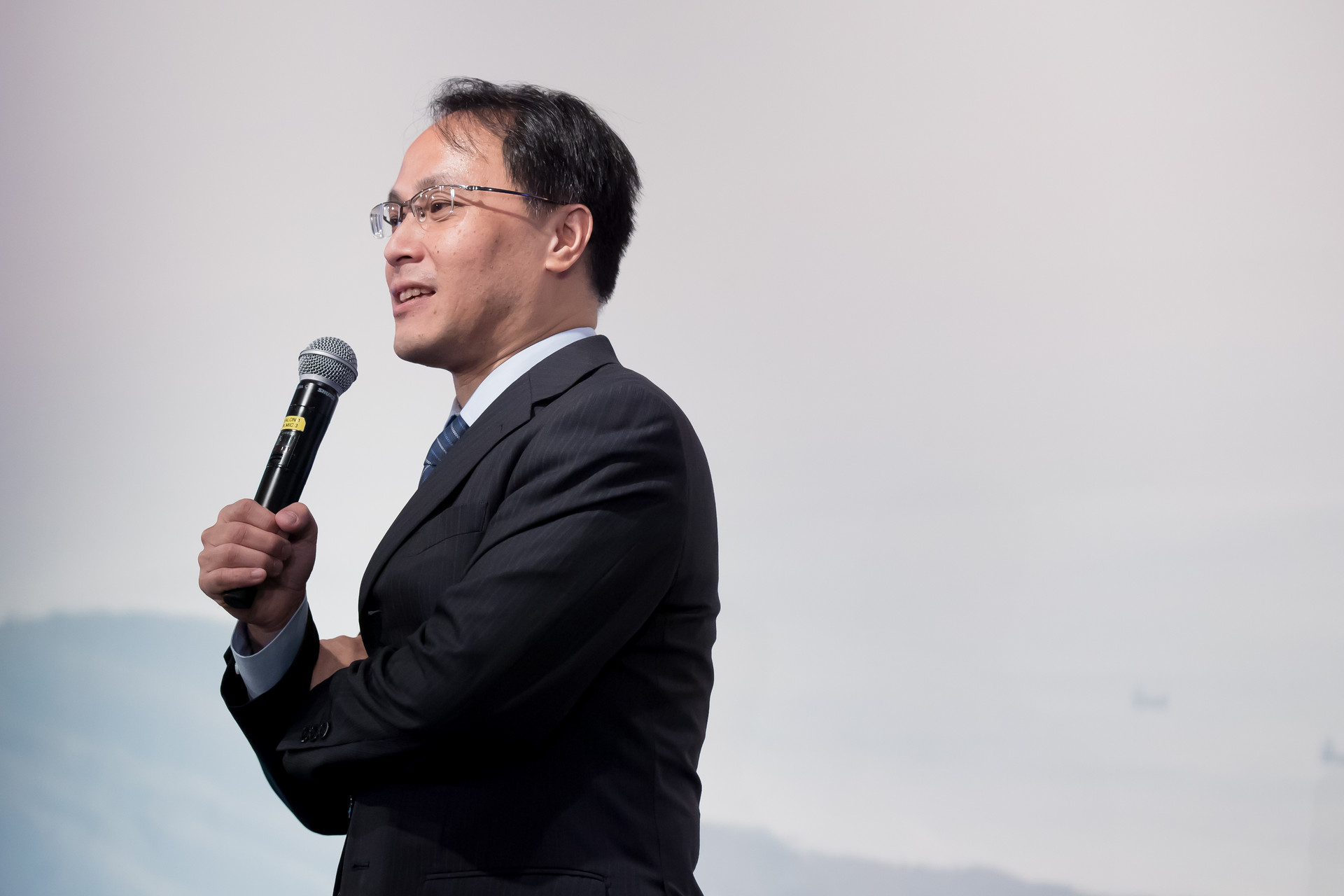 Asian businessmen holding microphone