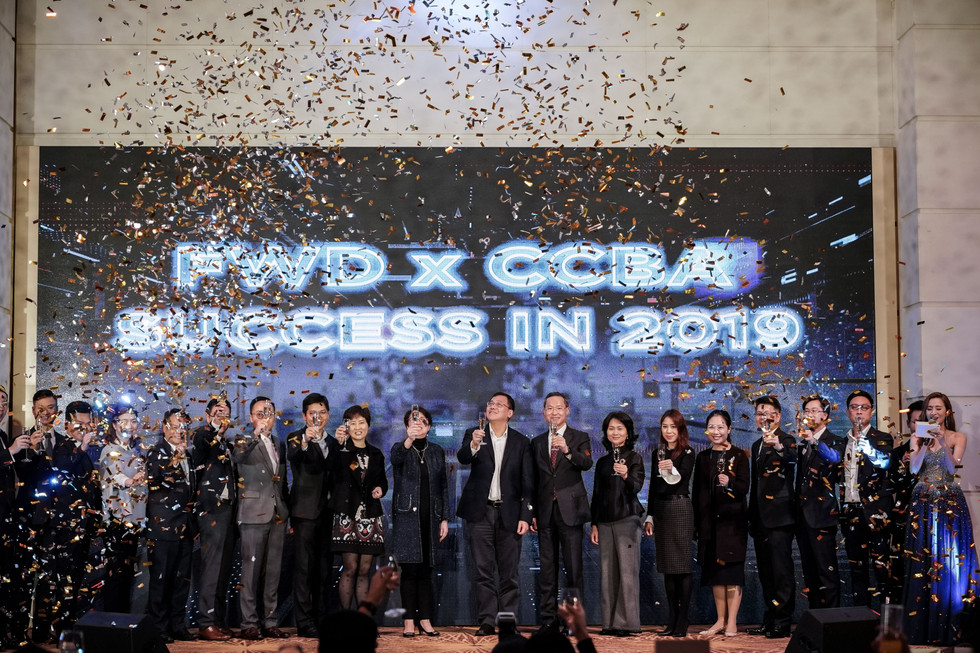 FWD x CCBA Annual dinner stage with confetti and management with champagne