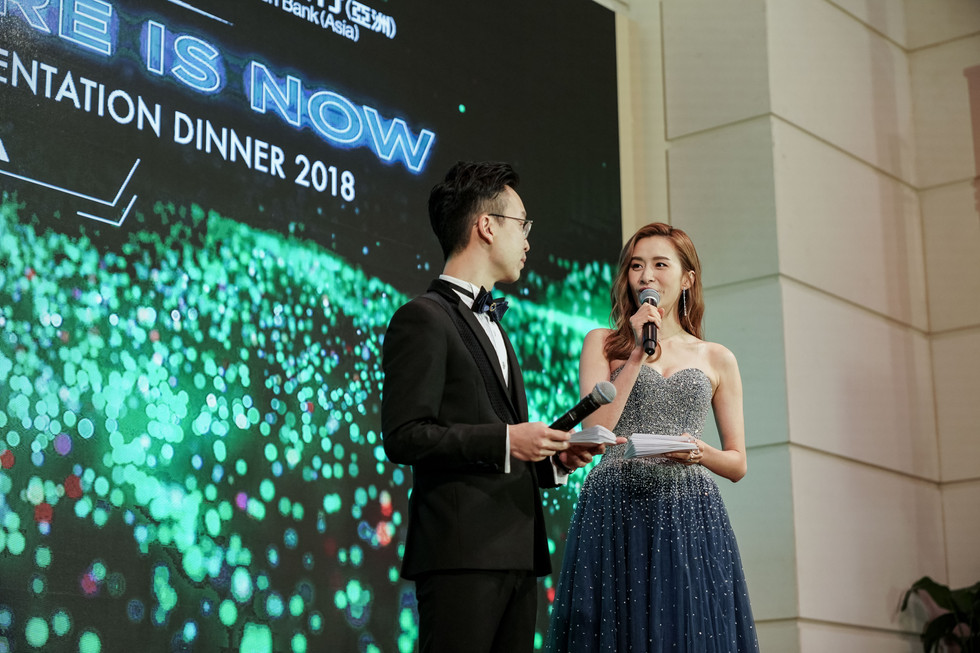 asian man and women interacting on stage of Hong Kong event