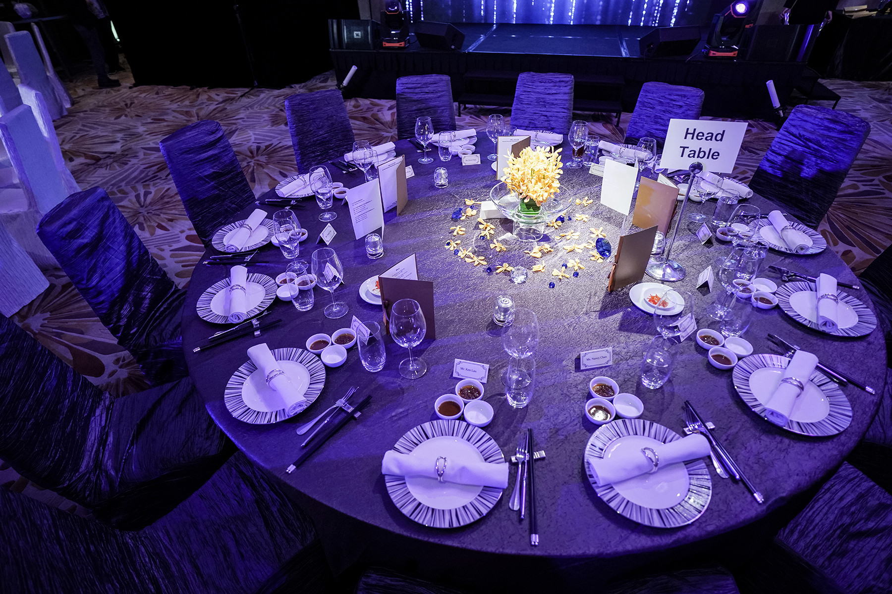 FWD x BOCOM annual dinner round table setup with purple ambient lighting