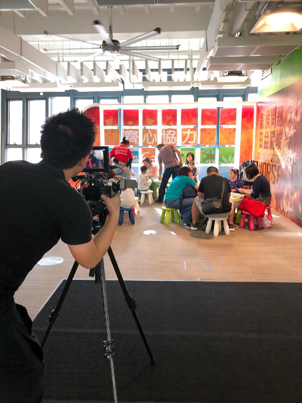 Videographer recording workshop of parents and children