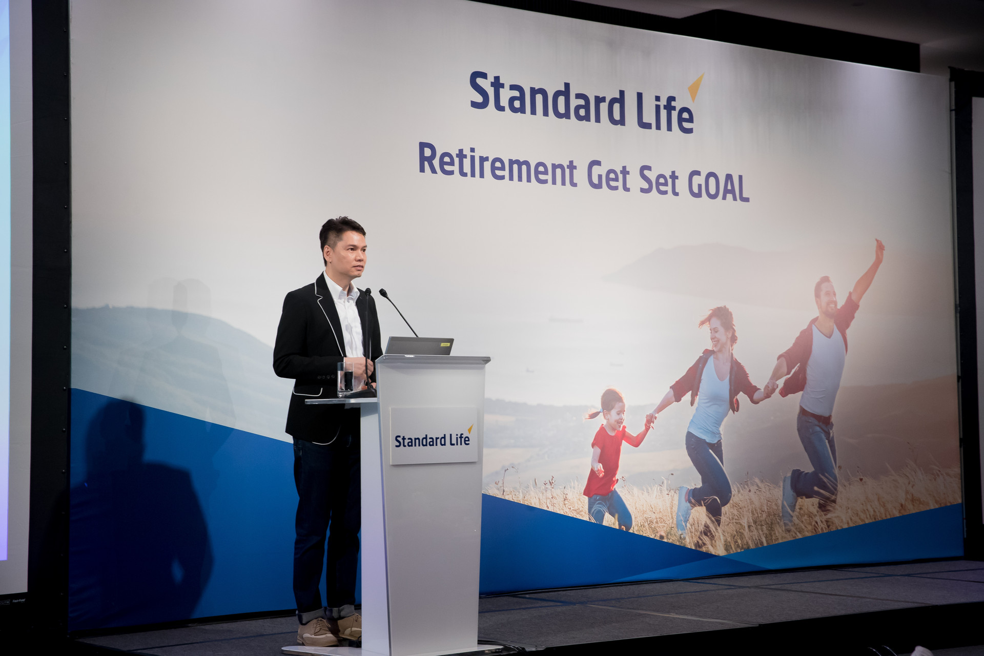 Standard Life Retirement Get Set Goal stage with asian men in suit with podium