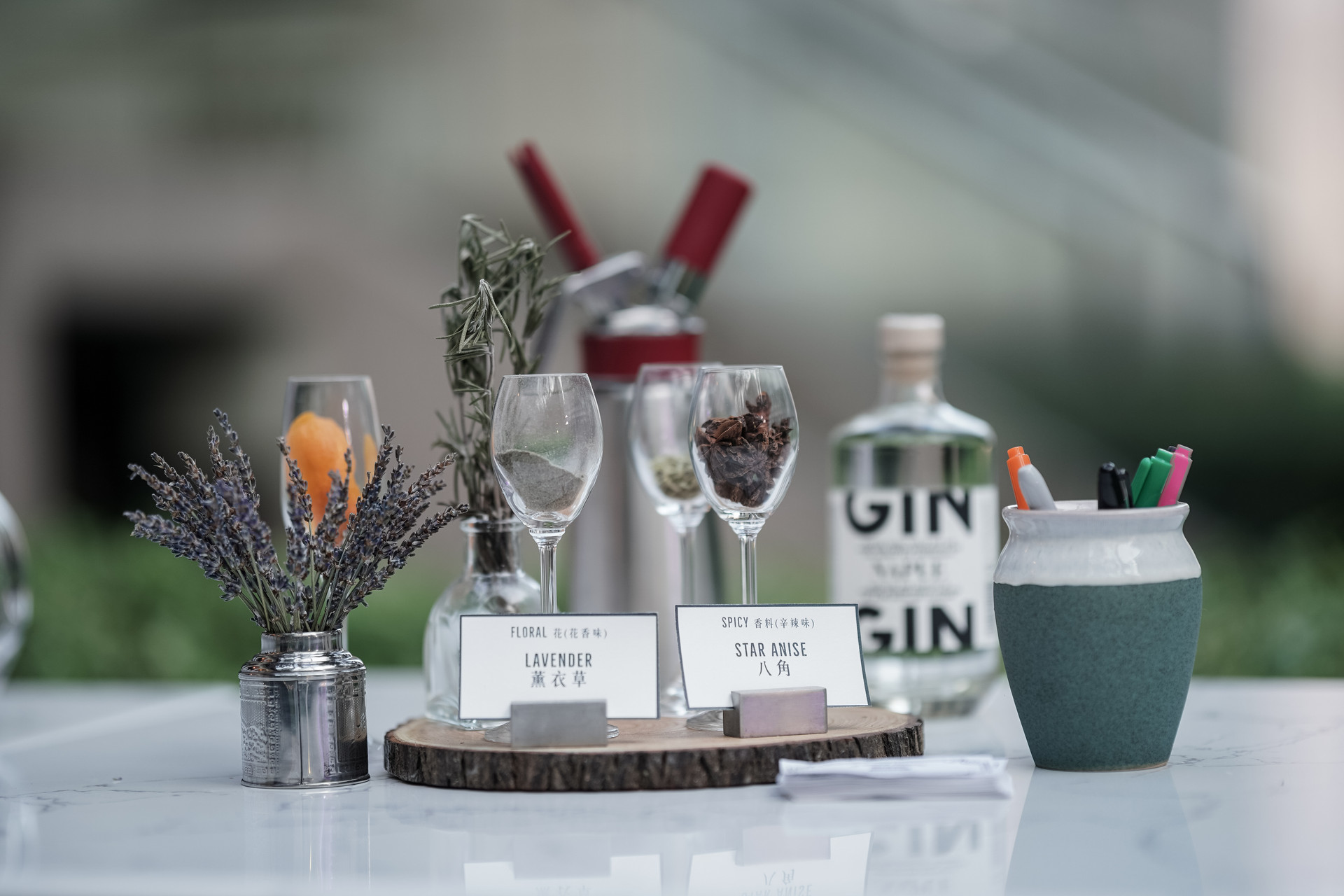 Gin infused with tea display with glasses