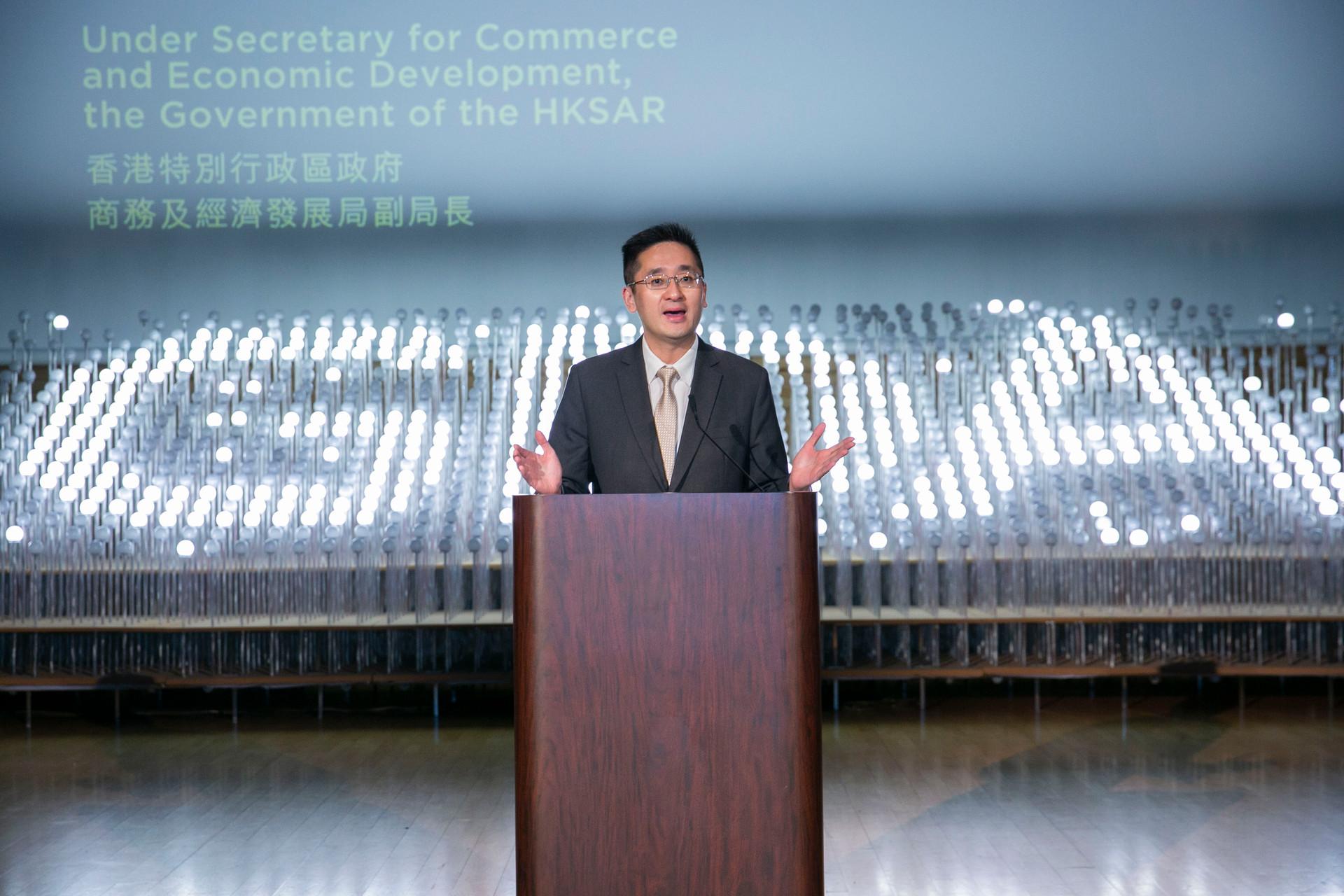 Asian men with brown wood podium in HKDA Global Design Awards