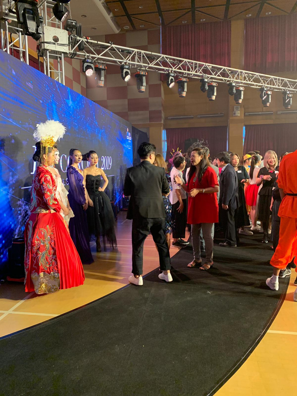 Group of cultural costume on fashion runway