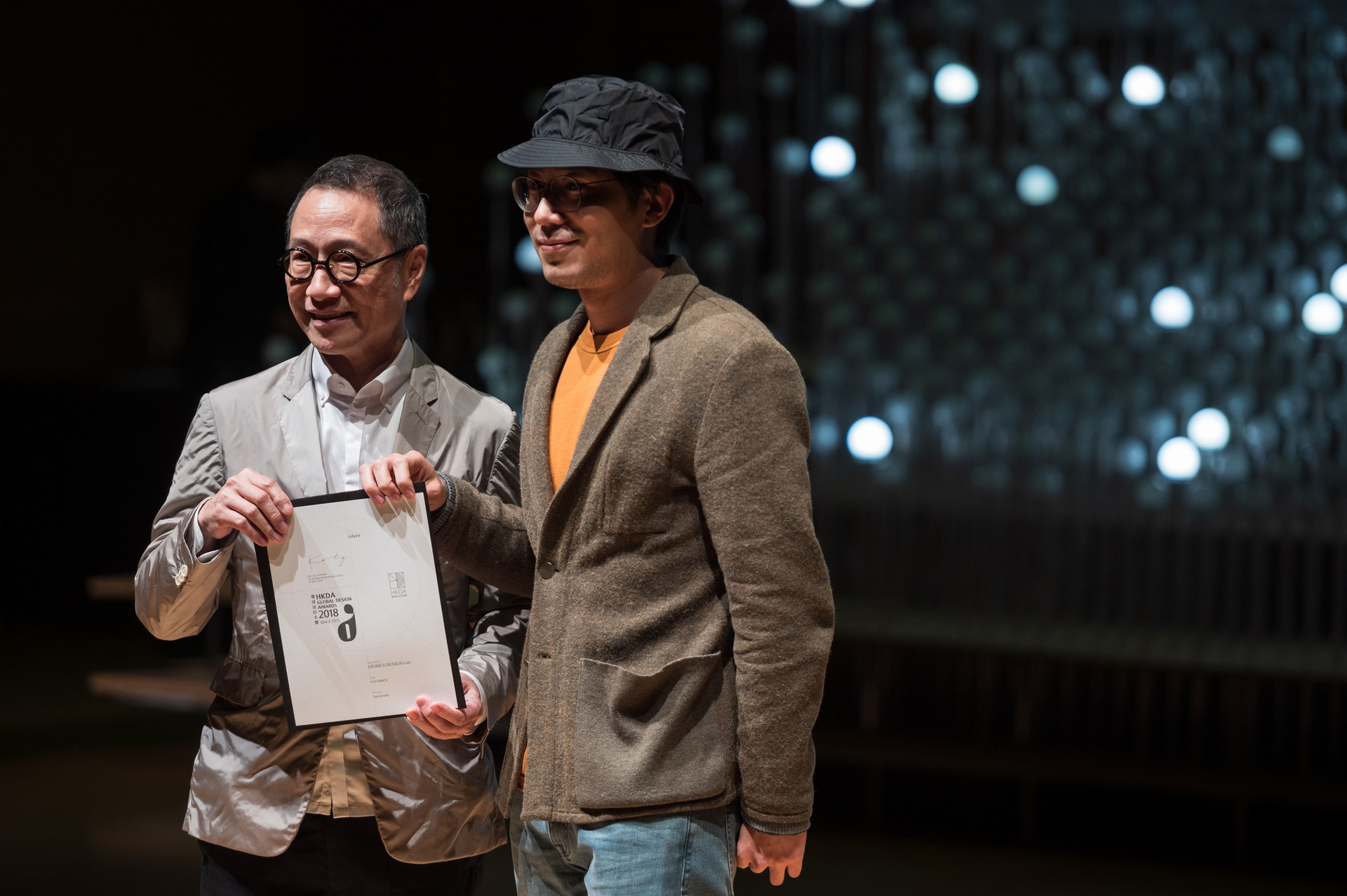 2 asian men with HKDA Global Design Awards certificate presented
