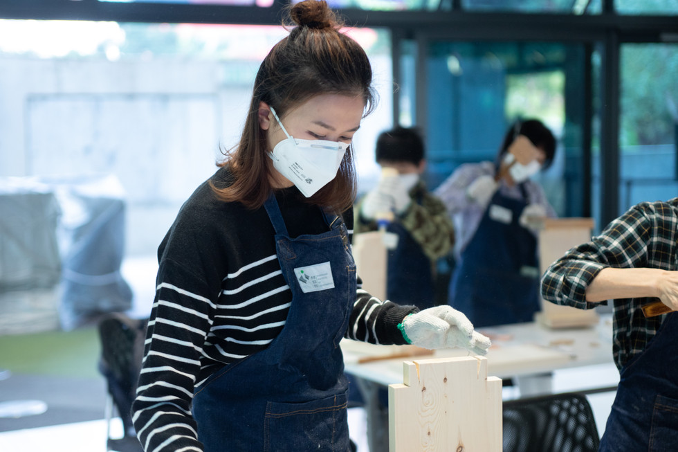 Asian women with mask working on carpentry
