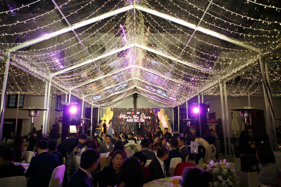 FWD x ICBC Annual dinner with vibrant orange and purple lighting in tent