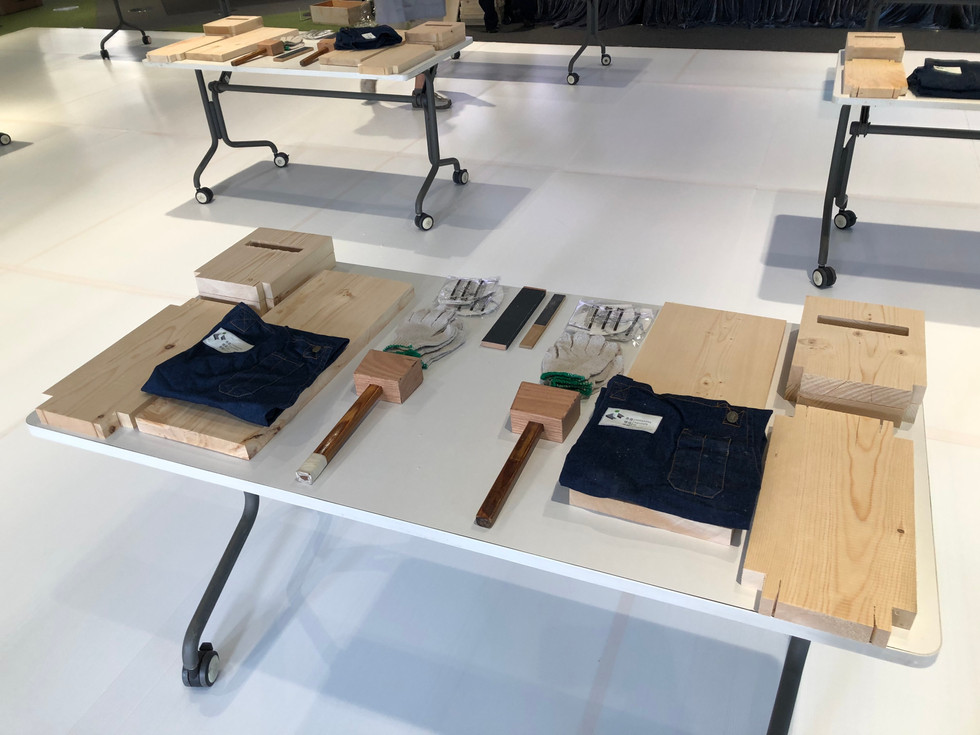 Carpentry workshop table setup with wood materials and hammer
