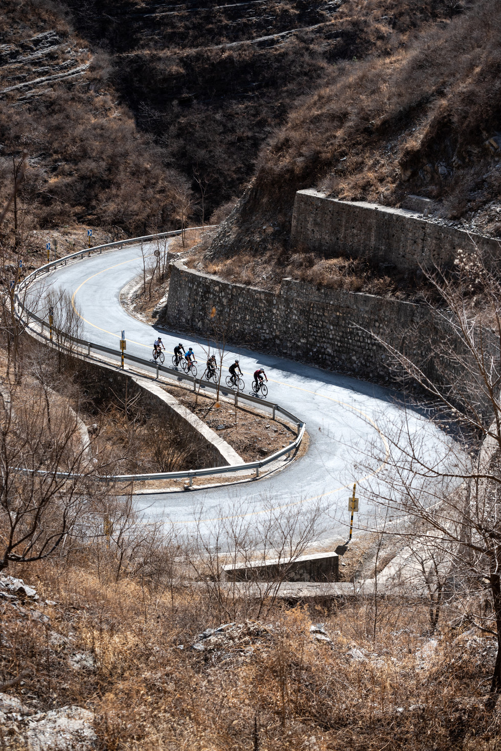 7 cyclist on a winding mountain road in China