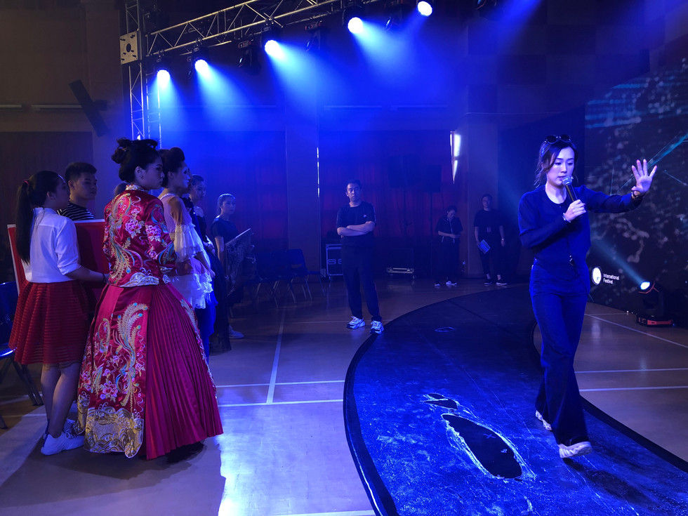 Asian women guiding a fashion show