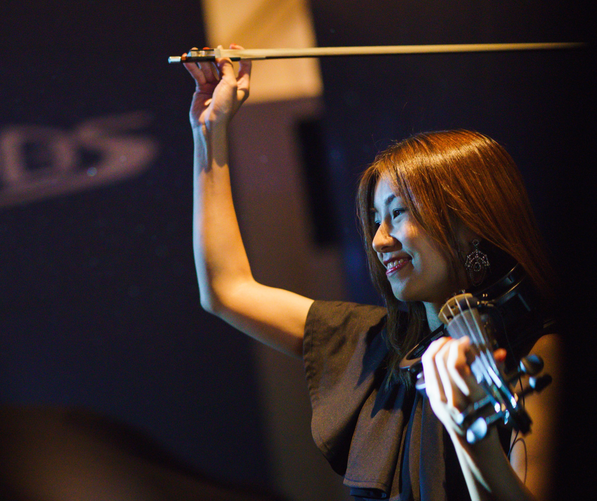 An asian lady playing the violin