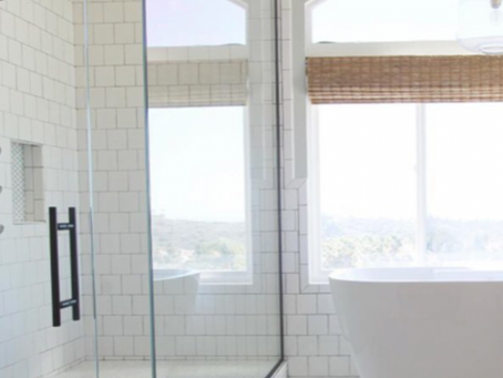 Custom frameless glass shower enclosed with a tile bench