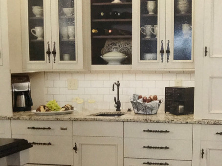 OPEN GLASS CABINETS IN THE KITCHEN BRING IT ALL TOGETHER AND HAS A LOVELY APPEARANCE .