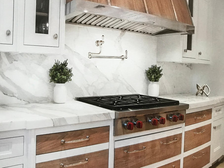 THE RANGE HOOD BRING OUT THE BEAUTY OF THE ENTIRE KITCHEN FOR A PROFESSIONAL LOOK !
