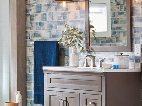 A elegant bathroom vanity with a beautiful tile back round