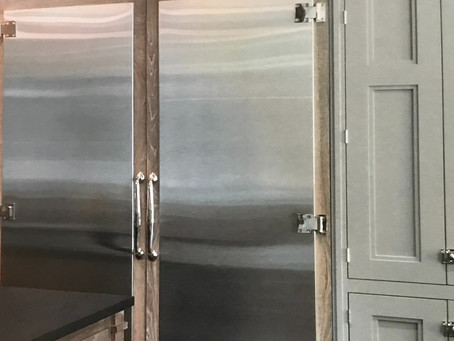 Covering refrigerator doors in stainless steal looks beautiful