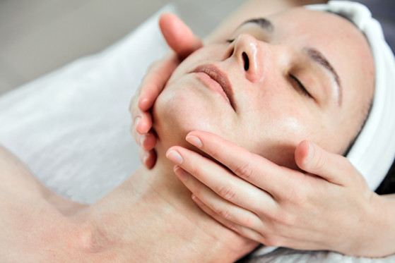 Face massage. Facial skincare. Hands of