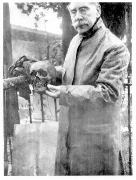 William Henry Bishop holding Smithson's skull during exhumation, 1903. Photo Courtesy of Smithsonian Institution