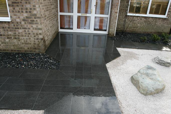Basalt paving looks a couple shades darker when wet