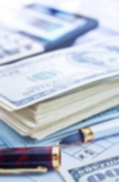 stack-of-cash-paying-bills.jpg