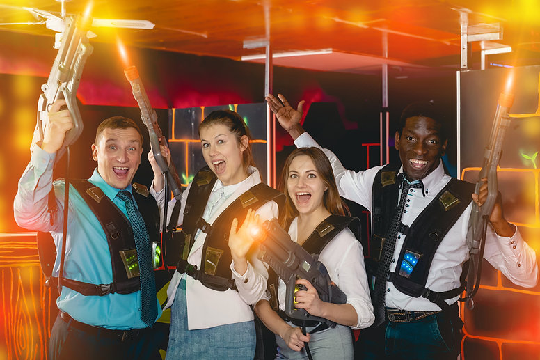 Group of jolly co-workers holding laser