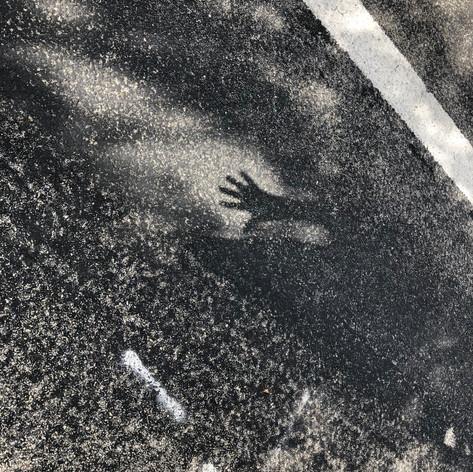 Hand Shadow on Asphalt