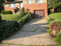 Retaining wall and driveway before