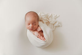 wrapped up newborn photographer leander tx