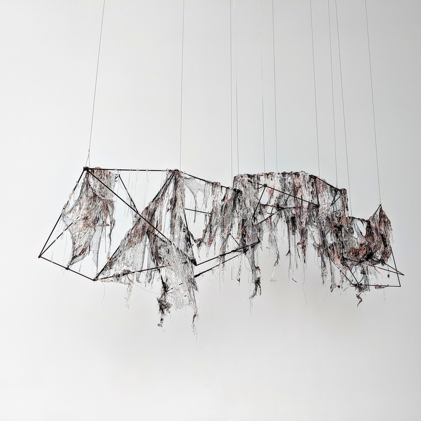 Tarkowski, Christine born: 1967 United States  SELECTOR STATEMENT In Copper Pour, molten glass and copper are employed to stretch across and conceal geometric armatures. The resulting work choreographs a series of moments in time: the repetition of process expediting a disintegration of order.  –Lipman, Beth