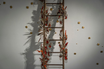 Descent of the Holy Spirit Installation view  2021 Wooden ladder, Shoe mold, Glass jars, Handmade origami stars (made of old maps, painted with acrylic), acrylic on paper, rope, various found bird feathers, baked soil from Angels Gate location. 10' x 4' x 4'