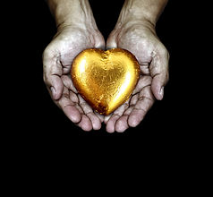 A golden heart in the care of a pair of