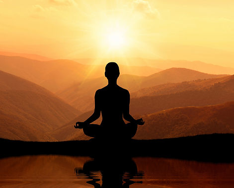Man meditating in yoga position on the