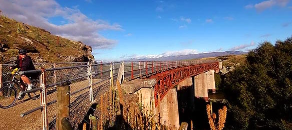 Otago Central Rail Trail - Steph finishes crossing Manuherikia No. 1 Bridge - 583x372 - Photo copyri