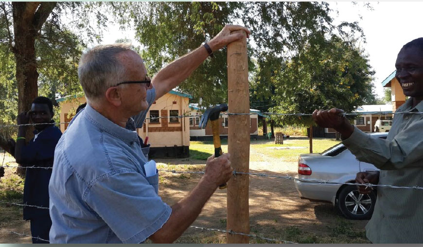 Chris fixing fence