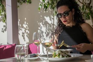 …enjoying Greek white Wine with salad…