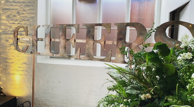 distressed wooden cheers sign.JPG