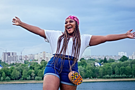 happy african woman afro braids dreadloc