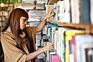 African American woman choosing a book i