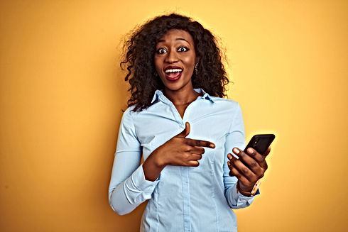 Young african american woman using smart