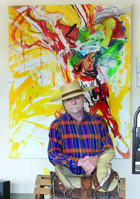 Walter Piehl poses in front of one of his art pieces.  His work will be displayed at the new Northwest Art Center gallery opening in the Gordon B. Olson Library.