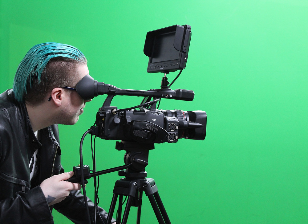 Broadcasting student Kyle Ludwig operates a camera in the department's TV studio.