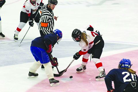 MSU sophomore MacKenzie Balogh (right) battles for the puck.  MSU deafted Midland Univerysity, 3-2, at the Maysa Arena.  The Beavers hosted Assiniboine College on Oct. 28 at 7:30 p.m. and Oct. 29 at 1 p.m. at the Maysa Arena.