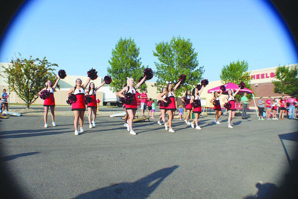 MSU cheer team shows off its team spirit at teh Scheels Tailgate at Dakota Square Mall