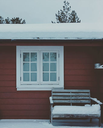 happiness exists and it is a red cabin with snow on