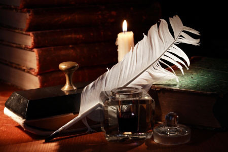 Quill, ink, candle and books image