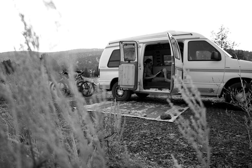 Black and white photo of a campervan