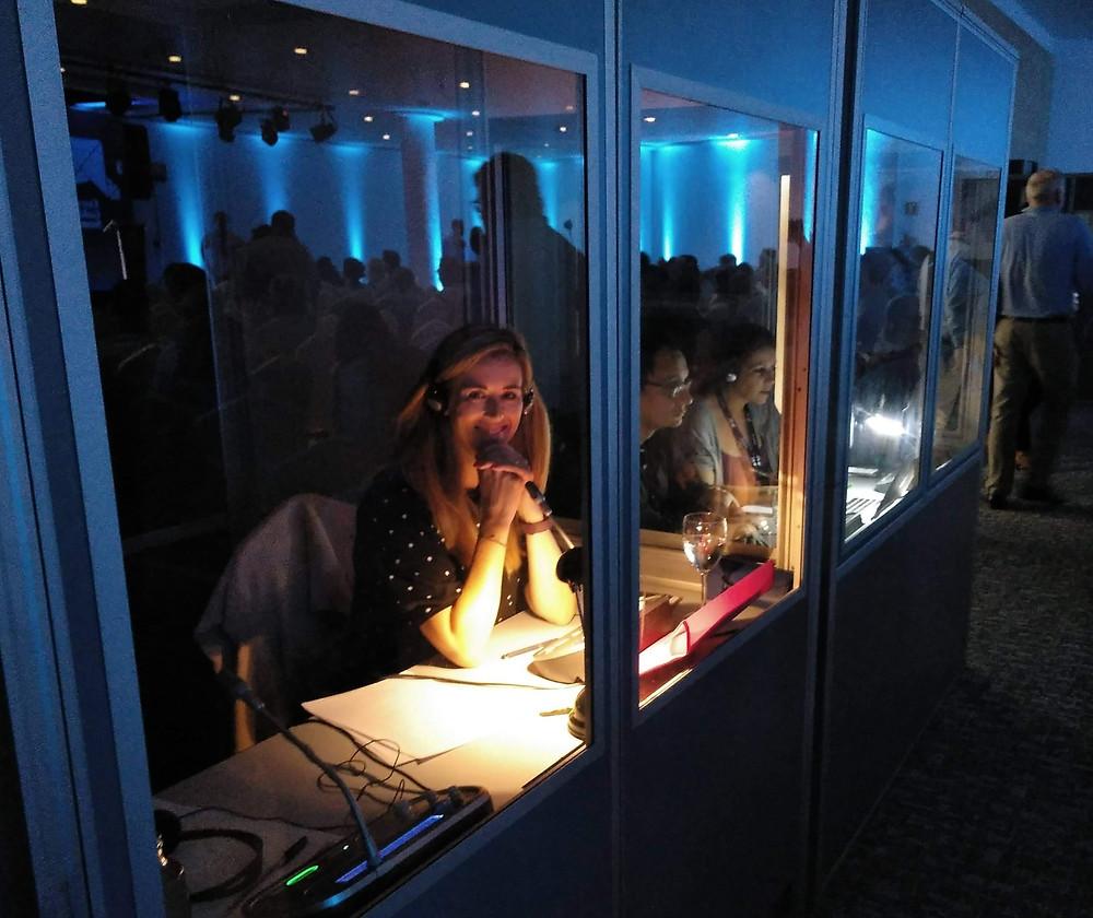 translator sitting in a booth